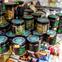 07 December 2017, Prague, Czech Republic: Sale of cannabis and other herbs in jars as a souvenir in the store